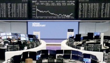 World stocks perk up as volatile week ends on a high