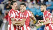 Suarez fires ATM to La Liga top