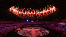 Tokyo Olympics open in low-key ceremony without fans