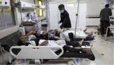 Afghan school blast toll rises to 58 as families begin burying victims
